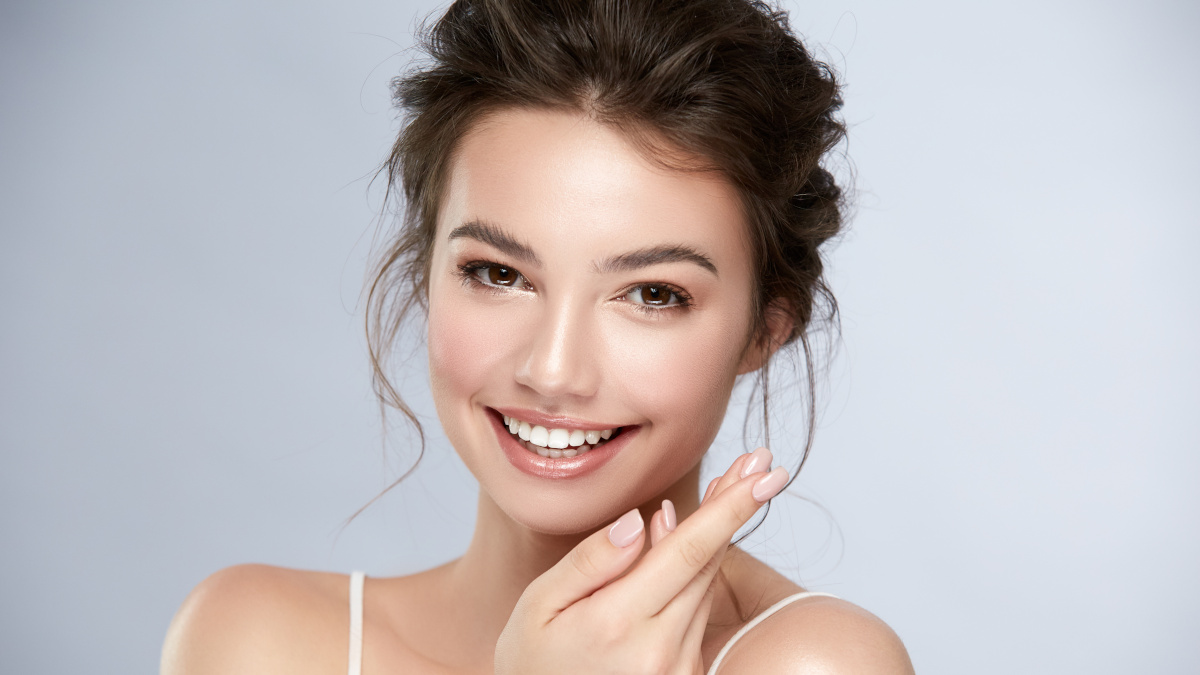Smiling woman with beautiful, moisturised skin