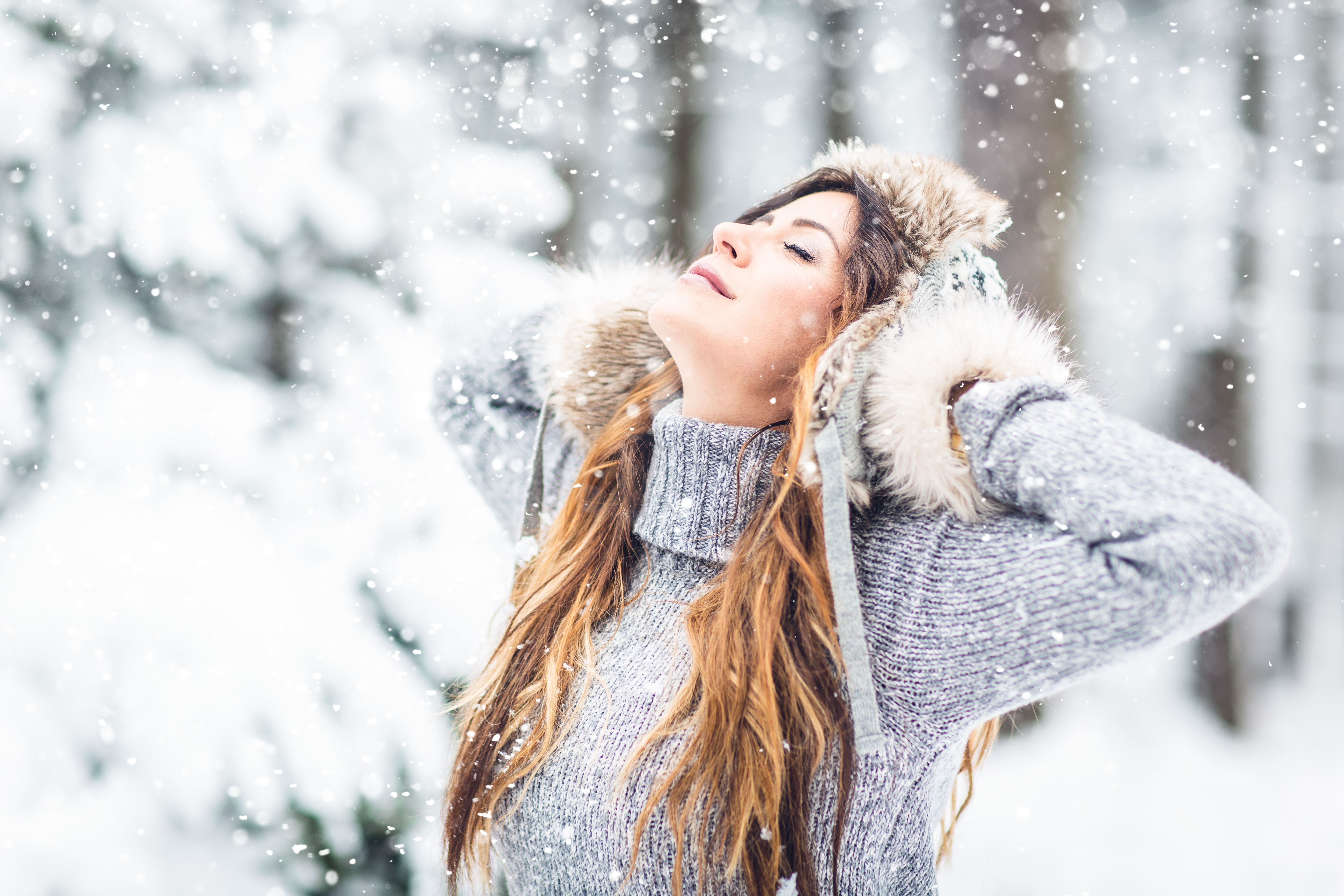 Woman enjoying the forest in winter